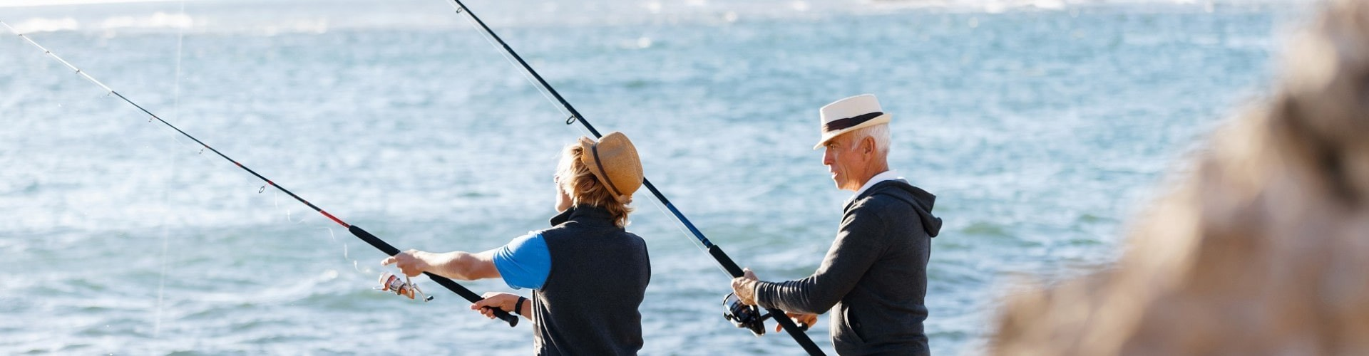 senior couple fishing at the ocean